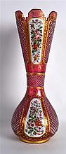 A LARGE 19TH CENTURY BOHEMIAN RUBY AND WHITE ENAMEL OVERLAID GLASS VASE of