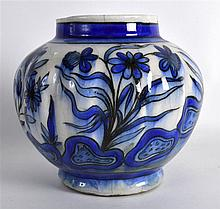 A 19TH CENTURY PERSIAN BLUE AND WHITE LOBED VASE painted with flowers. 6.75
