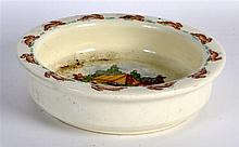 A ROYAL DOULTON BUNNYKINS POTTERY CHILDS PLATE. 6.25ins diameter.