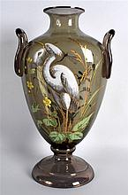 AN EARLY 20TH CENTURY ENGLISH TWIN HANDLED IRIDESCENT VASE enamelled with a