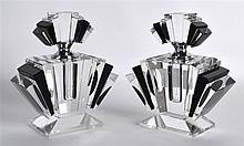 A SMALL PAIR OF ART DECO STYLE BLACK AND CLEAR GLASS SCENT BOTTLES AND STOP