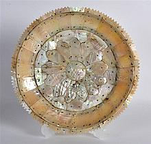 AN UNUSUAL INDIAN CARVED MOTHER OF PEARL CIRCUALAR PLATE with floral type c