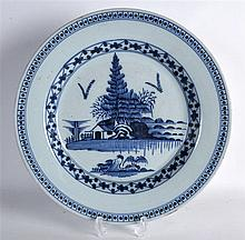 AN 18TH CENTURY DELft BLUE AND WHITE CIRCULAR PLATE painted with an island