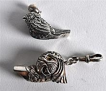 TWO NOVELTY SILVER BIRD WHISTLES. (2)