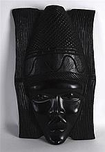 AN AFRICAN CARVED HARDWOOD MASK. 1ft 4ins high.