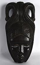 AN AFRICAN CARVED HARDWOOD MASK. 1ft 1ins high.