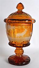 A LOVELY BOHEMIAN SMOKEY AMBER GLASS GOBLET AND COVER decorated with a stag