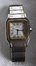 A BOXED GENTLEMANS CARTIER SANTOS GALBEE WRISTWATCH gold and stainless stee