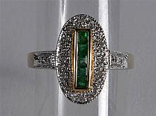 A 9CT GOLD EMERALD AND DIAMOND DECO STYLE RING.