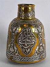 A MID 19TH CENTURY ISLAMIC SILVER INLAID MIXED METAL VESSEL decorated with
