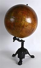 AN ANTIQUE A BROWN & SONS LTD 12INCH TERRESTRIAL GLOBE upon an iron base. 1