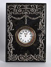 A RUSSIAN SILVER AND HARDSTONE STRUT CLOCK in the Faberge style, overlaid w