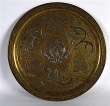 A MID 19TH CENTURY ISLAMIC BRASS AND SILVER INLAID TRAY decorated with scro