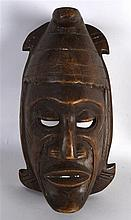 AN AFRICAN CARVED WOODEN MASK. 11.25ins long.
