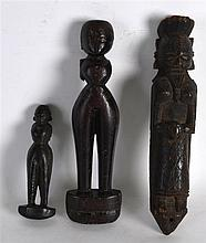 AN UNUSUAL GROUP OF THREE 19TH CENTURY CARVED HARDWOOD FIGURES possibly Afr