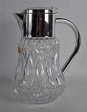 A SILVER PLATED CRYSTAL DECANTER. 11Ins high.