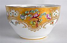 19TH C. COALPORT BOWL painted with birds and flowers on a highly gilt groun