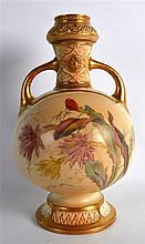 ROYAL WORCESTER TWO HANDLED VASE of Persian inspiration painted with flower