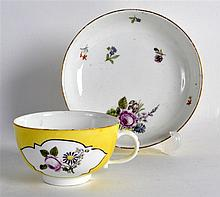 18TH C. MEISSEN YELLOW GROUND TEACUP AND SAUCER painted with panels of flow