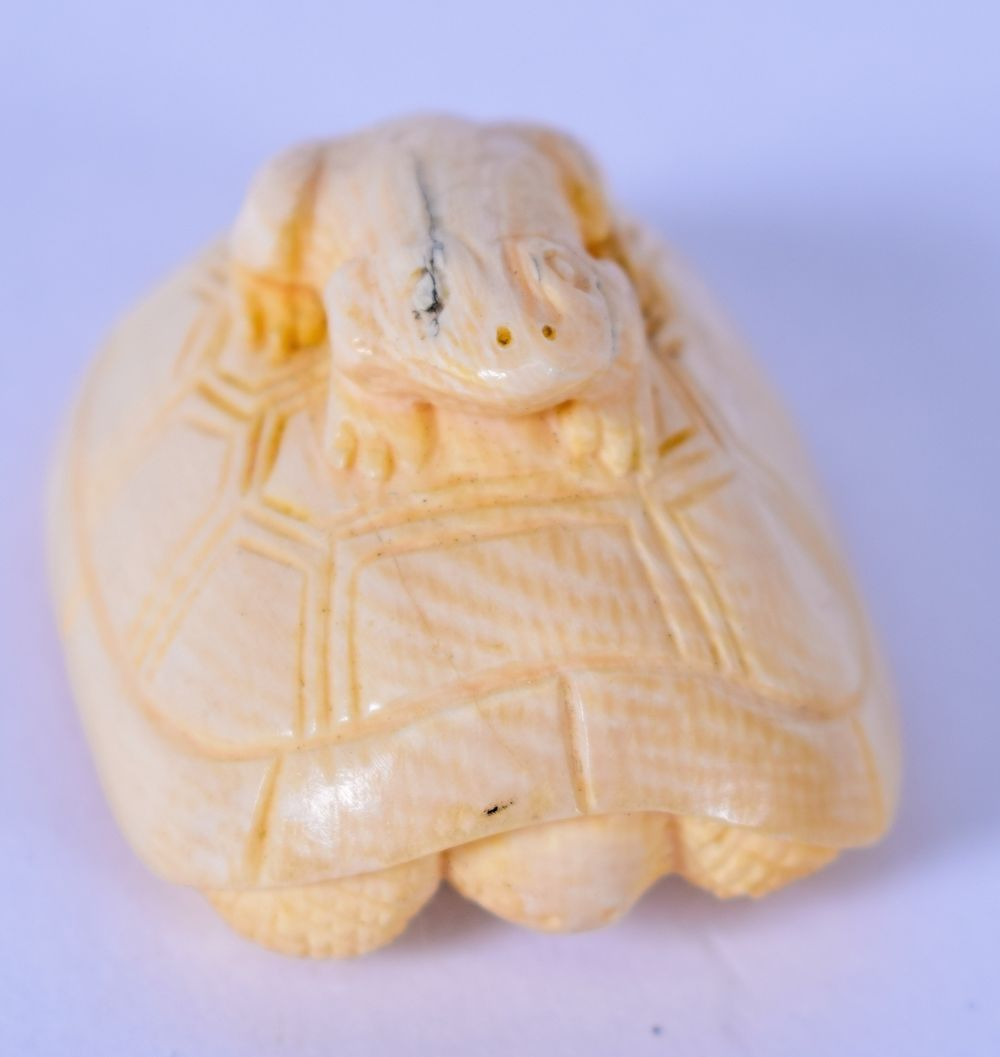 An Early 20th Century Japanese Carved Bone Netsuke In The Form Of A Seated Toad Upon The Back Of A Tortoise Signed 4 2 Cm Wide