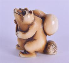 A 19TH CENTURY JAPANESE MEIJI PERIOD CARVED IVORY NETSUKE modelled as a bea