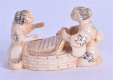 AN EARLY 20TH VENTURY JAPANESE MEIJI PERIOD CARVED IVORY NETSUKE modelled a