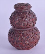 A CHINESE QING DYNASTY CINNABAR LACQUER SNUFF BOTTLE overlaid with flowers.