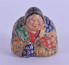 AN UNUSUAL EARLY 20TH CENTURY POLYCHROMED WOODEN NETSUKE in the form of a s