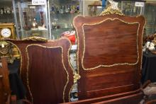 A FRENCH MAHOGANY BED FRAME, with ormolu fittings. 194 cm long x 114 cm.