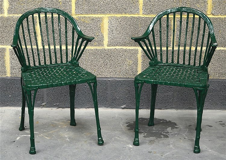 A pair of vintage green painted cast iron garden chairs Cast iron garden furniture