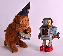 A VINTAGE CHINESE WIND UP TIN PLATE ROBOT together with a wind up drumming monkey. 6Ins & 8.5ins high. (2)