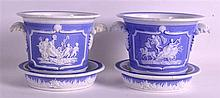 A PAIR OF MID 19TH CENTURY ENGLISH CACHE POTS ON STANDS decorated in relief with classical scenes. 5.5ins wide.