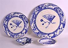 TWO ANTIQUE BLUE AND WHITE CIRCULAR STANDS together with a leaf shaped dish & a twin handled dish. Largest 10.5ins diameter. (4)