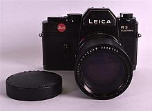 A LEICA LEITZ  R3 ELECTRONIC CAMERA the lens stamped Elmarit-R 1:2.8/135, Leitz Wetzlar 2298169.