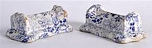 A PAIR OF 19TH CENTURY DAVENPORT BLUE AND WHITE POTTERY KNIFE RESTS decorated with floral sprays. 3.25ins wide.
