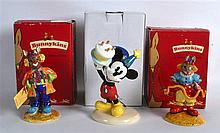 A PAIR OF BOXED ROYAL DOULTON BUNNYKINS FIGURES together with a boxed Royal Doulton disney figure. (3)