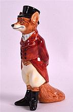 A ROYAL DOULTON FOX HUNTER FIGURE modelled in a traditional red jacket. 4.5ins high.