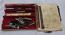 A BOX OF GUN RELATED ITEMS, mostly cleaning apparatus.