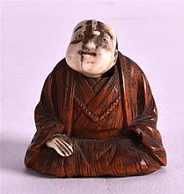 A 19TH CENTURY JAPANESE MEIJI PERIOD BOXWOOD AND IVORY NETSUKE the male with a 'popping' head. 1.25ins high.