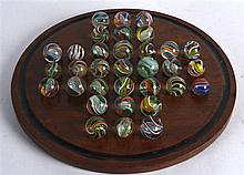 A GOOD SET OF SOLITAIRE MARBLES ON STAND of various sizes and internal deco