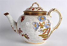 A ROYAL WORCESTER AESTHETIC MOVEMENT TEAPOT AND COVER painted with butterfl