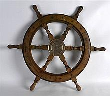 A VINTAGE BRASS BOUND SHIPS WHEEL. 2Ft 1ins wide.