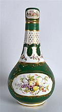 19th Century Rockingham bottle vase painted with fruit on a green ground in the