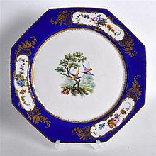 19th Century Sevres plate painted with birds in landscape  under a blue border w