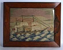 A LARGE FRAMED 19TH CENTURY MARITIME WOOLWORK PANEL depicting a boat with f