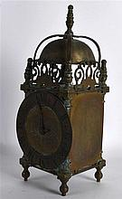 A VICTORIAN BRASS LANTERN CLOCK in the 17th Century style, the dial engrave