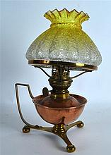 AN EARLY 20TH CENTURY COPPER AND GLASS OIL LAMP.