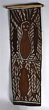 AN UNUSUAL CARVED AND PAINTED NATIVE AMERICAN WOODEN PANEL depicting abstra