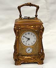 A FINE ART NOUVEAU FRENCH ORMOLU CARRIAGE CLOCK decorated with scrolling vi