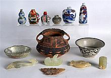 AN EARLY CHINESE POTTERY EAR CUP together with various snuff bottles, jade